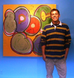 Joel Reid with a painting from his 'Robots in Disguise' exhibit at the Courthouse Art Gallery. Last weekend to catch it!