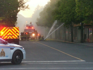 Crowds flocked downtown Monday evening after a fire broke out on Quilchena Ave.