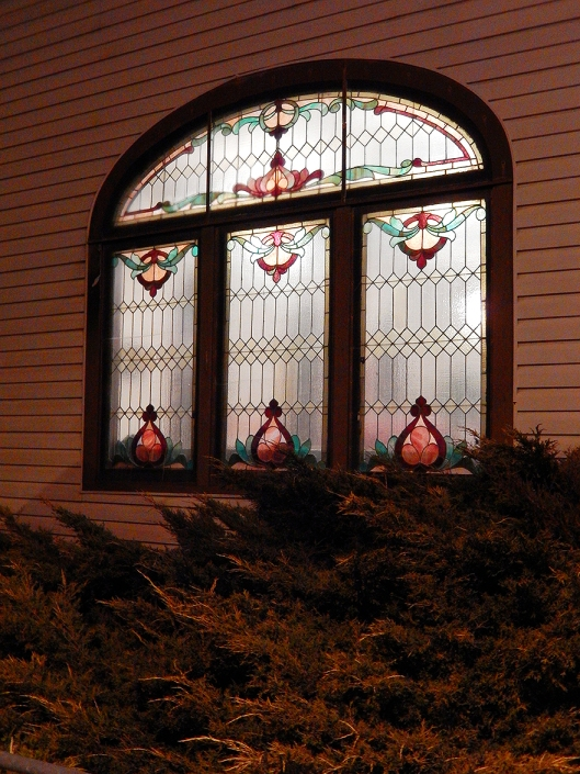With Christmas preparations, the beautiful stained glass windows of Trinity United Church are more often alit.